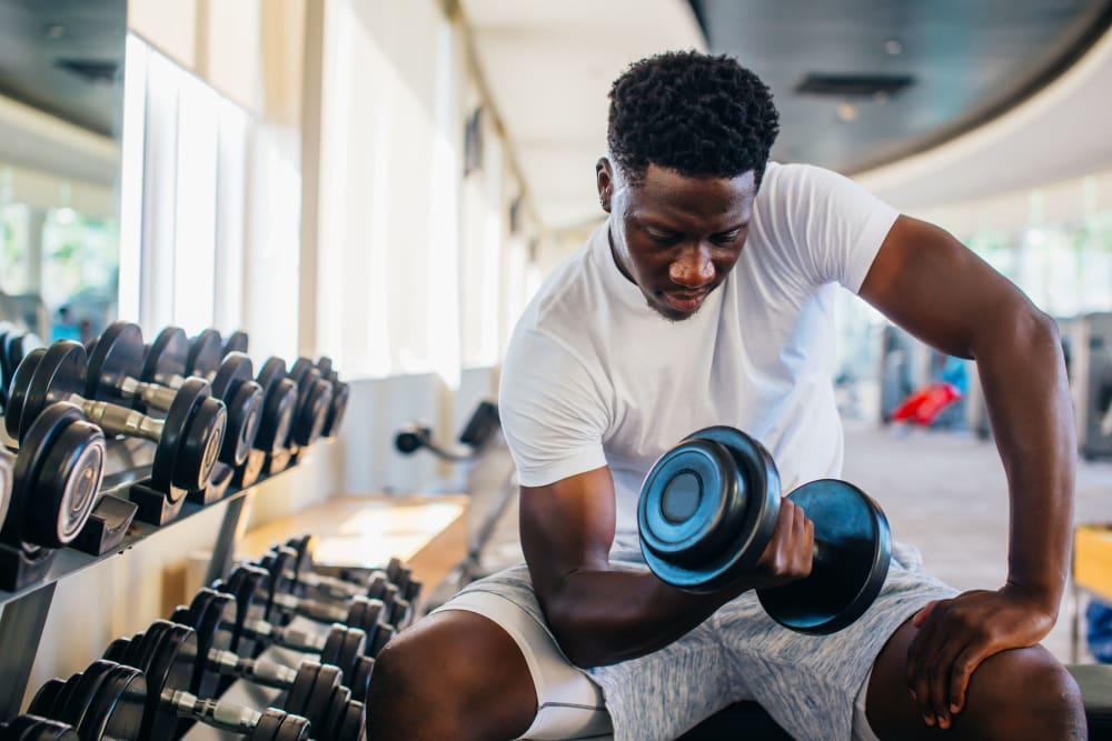 Student resident lifting weights at HERE Atlanta in Atlanta, Georgia