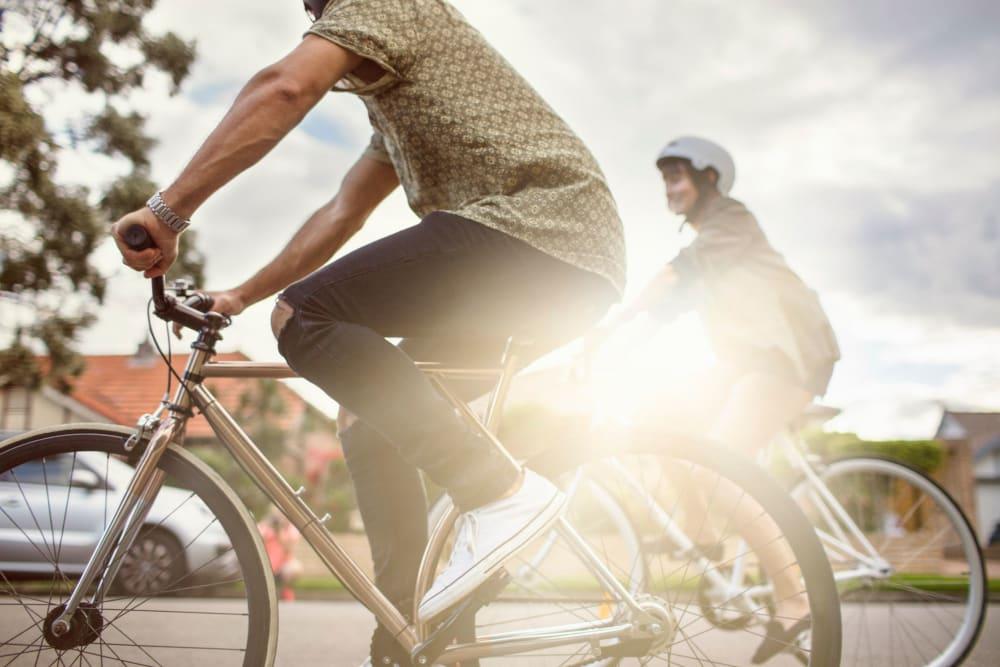 Student residents riding their bikes through Atlanta, Georgia near HERE Atlanta by Georgia Tech