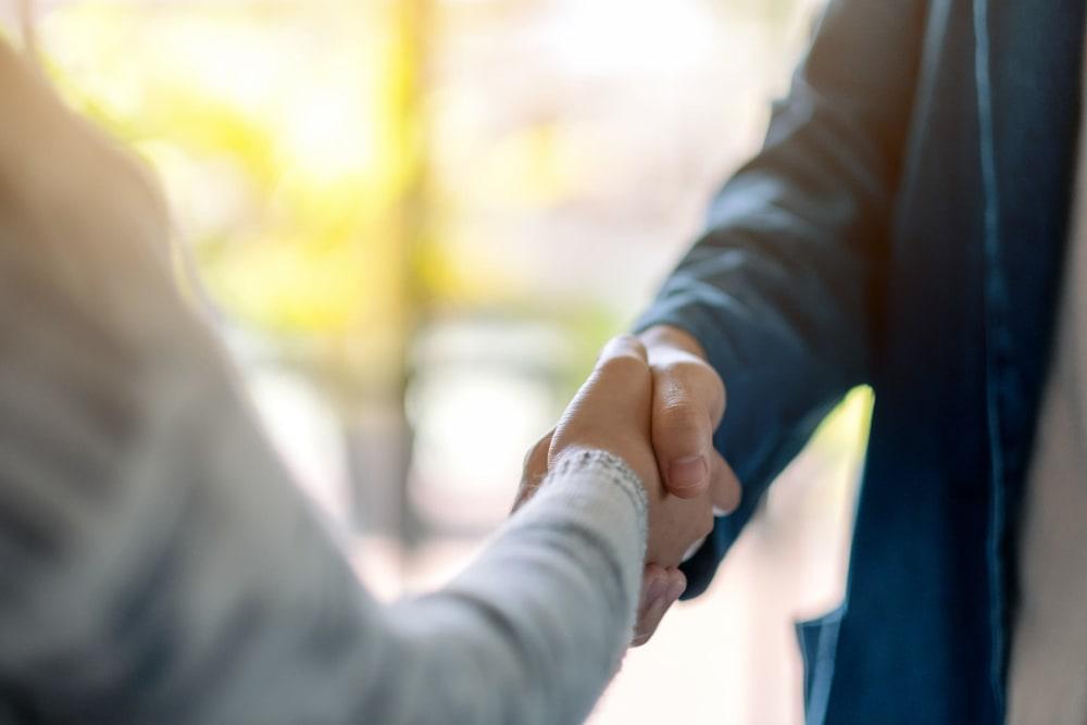 two businessmen shaking hands in Bethesda, Maryland near CAPREIT