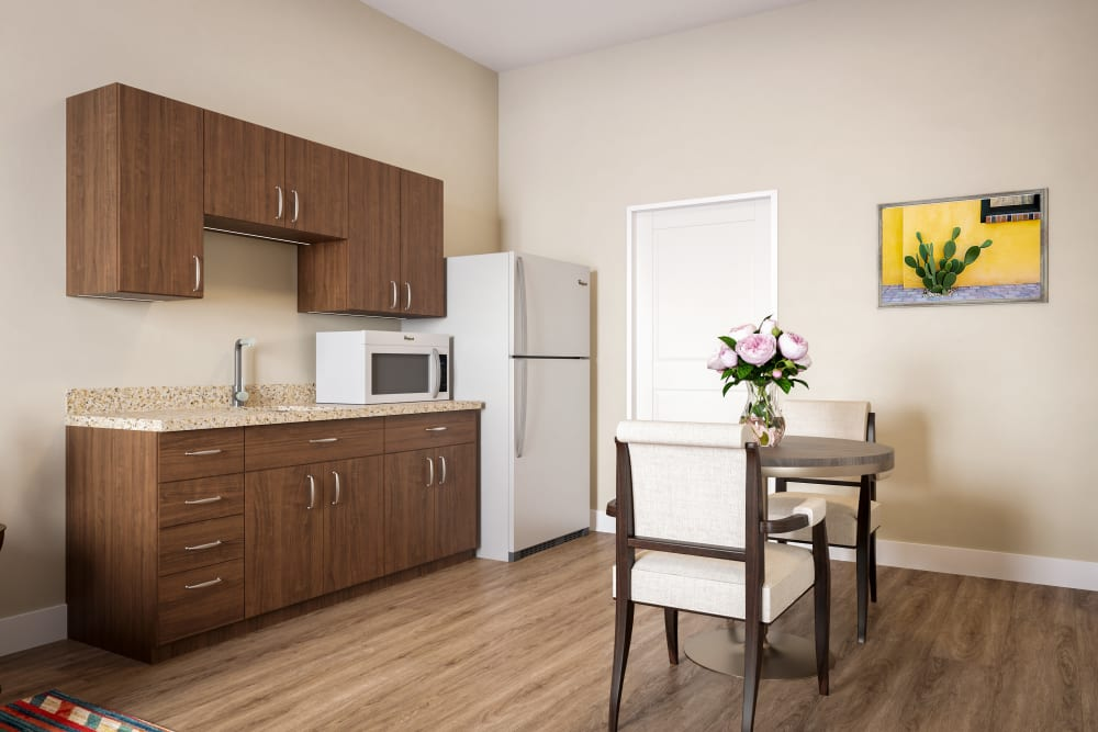 Assisted living model kitchenette and dining area at Ativo Senior Living of Yuma in Yuma, Arizona