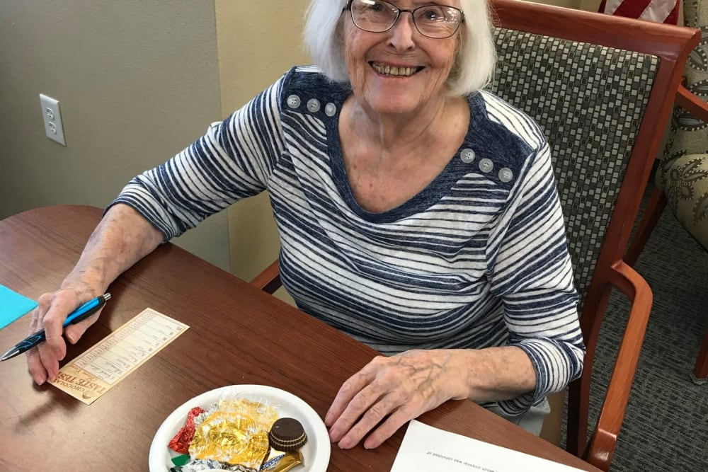 Resident participating in a chocolate taste test event at Keelson Harbour in Spirit Lake, Iowa