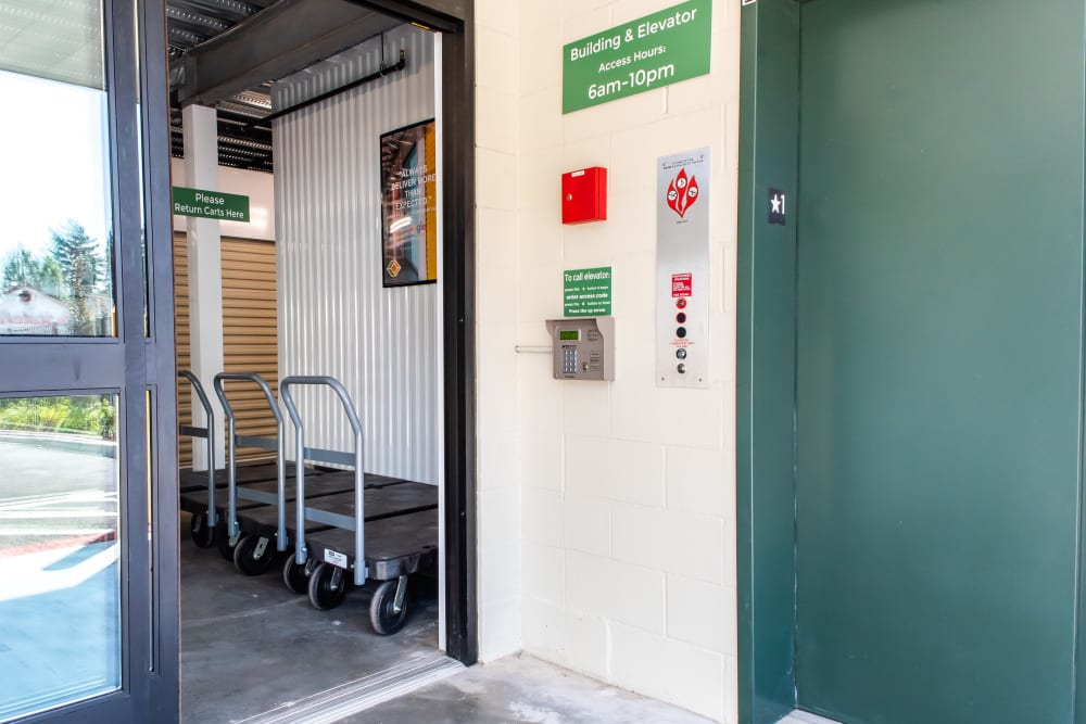 An elevator and moving carts at Cubes Self Storage in Covington, WA