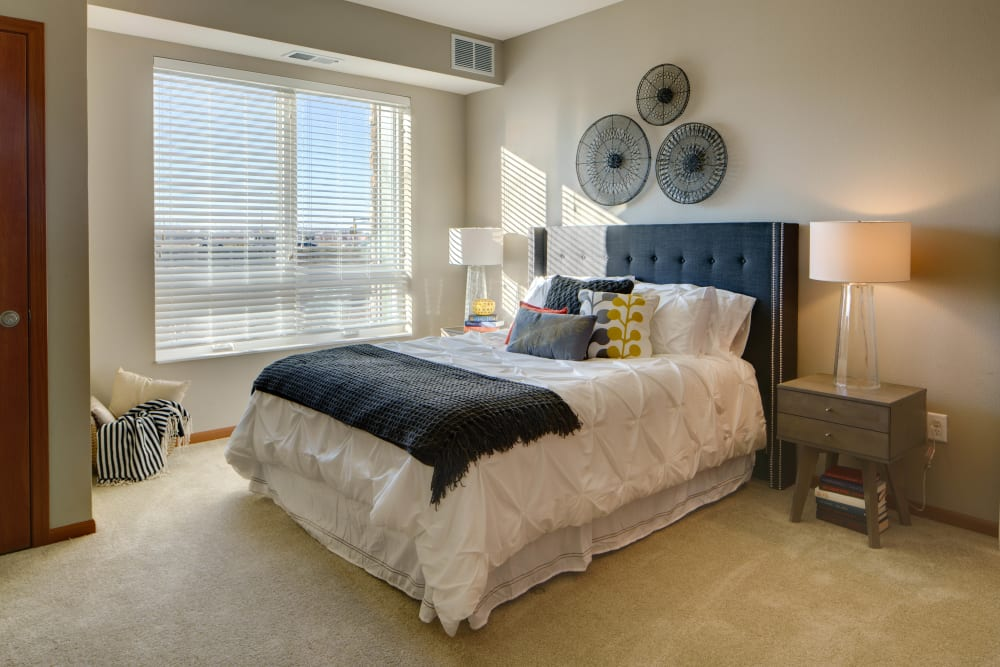 Spacious bedroom in the model home at Remington Cove Apartments in Apple Valley, Minnesota