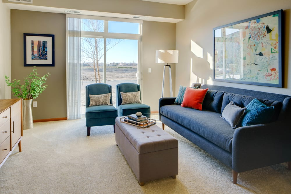 Living room with patio access at Remington Cove Apartments in Apple Valley, Minnesota