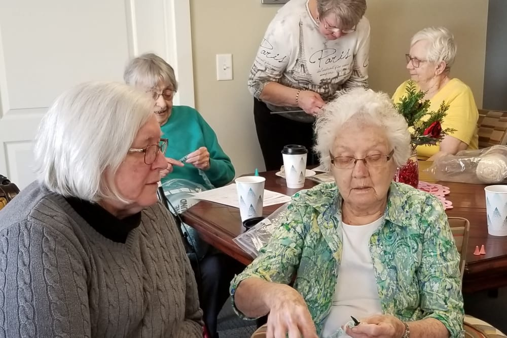 Two residents sitting together at Emery Place in Robins, Iowa