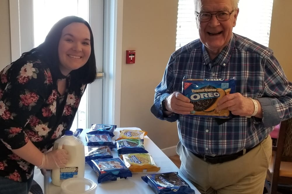 Staff and resident with cookies at Emery Place in Robins, Iowa