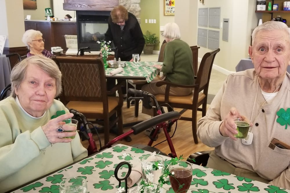 Residents celebrating St. Patrick's Day at Emery Place in Robins, Iowa