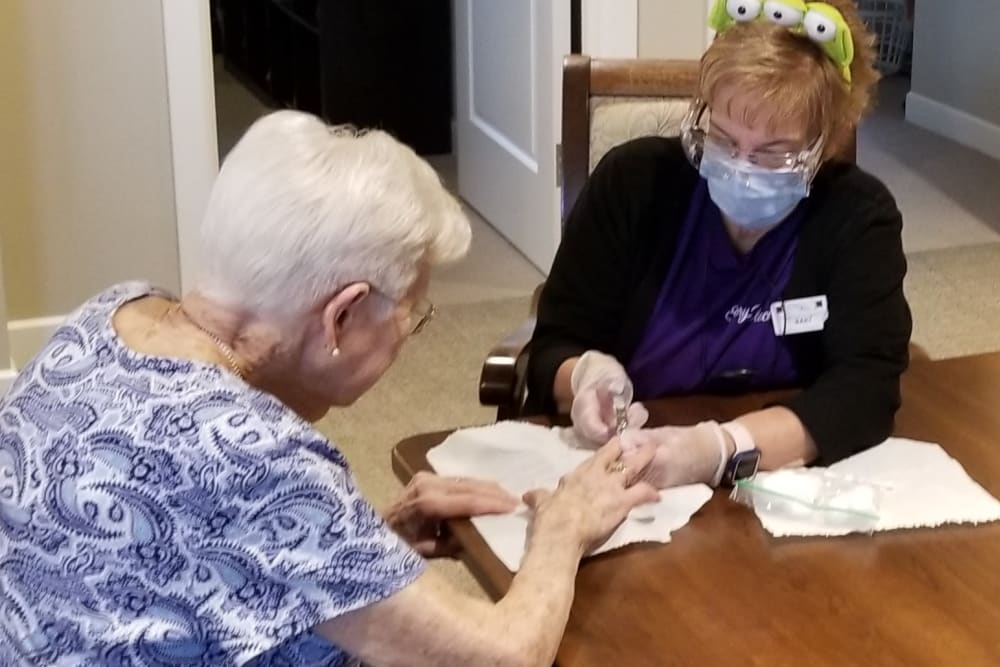 Staff helping resident at Emery Place in Robins, Iowa