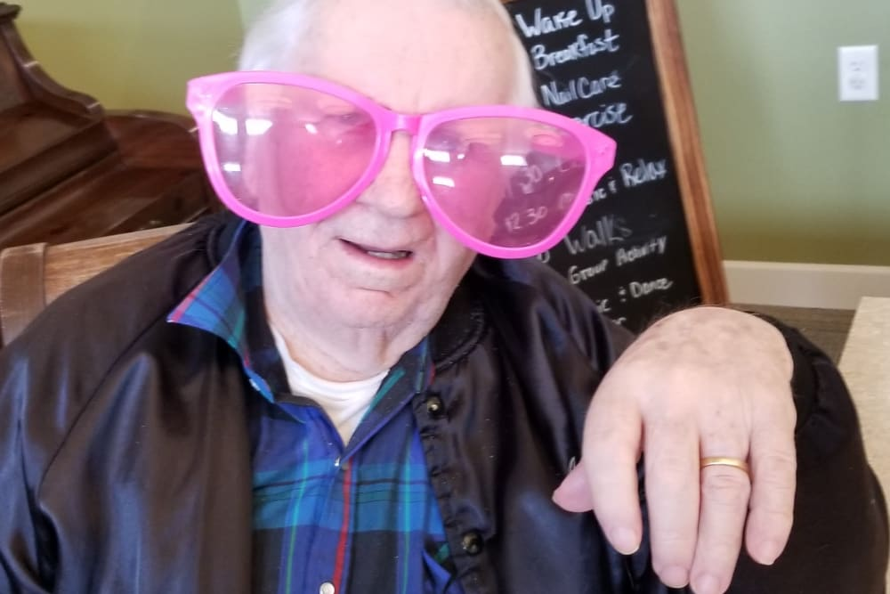 Resident with costume glasses at Emery Place in Robins, Iowa