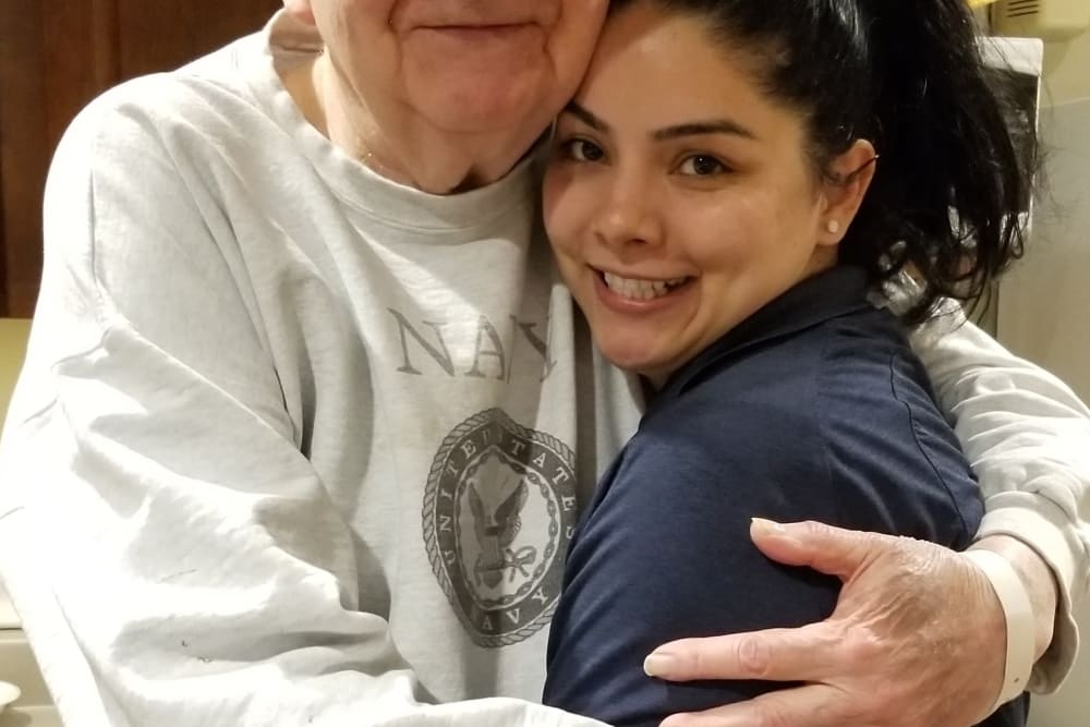 Resident hugging their granddaughter at Emery Place in Robins, Iowa
