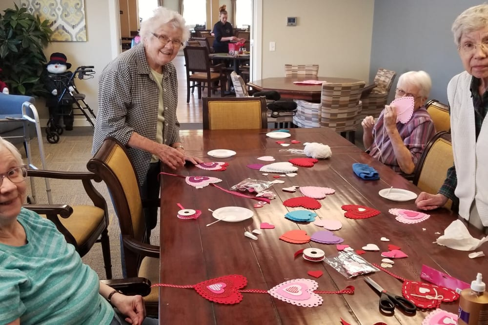 Residents celebrating Valentine's Day at Emery Place in Robins, Iowa
