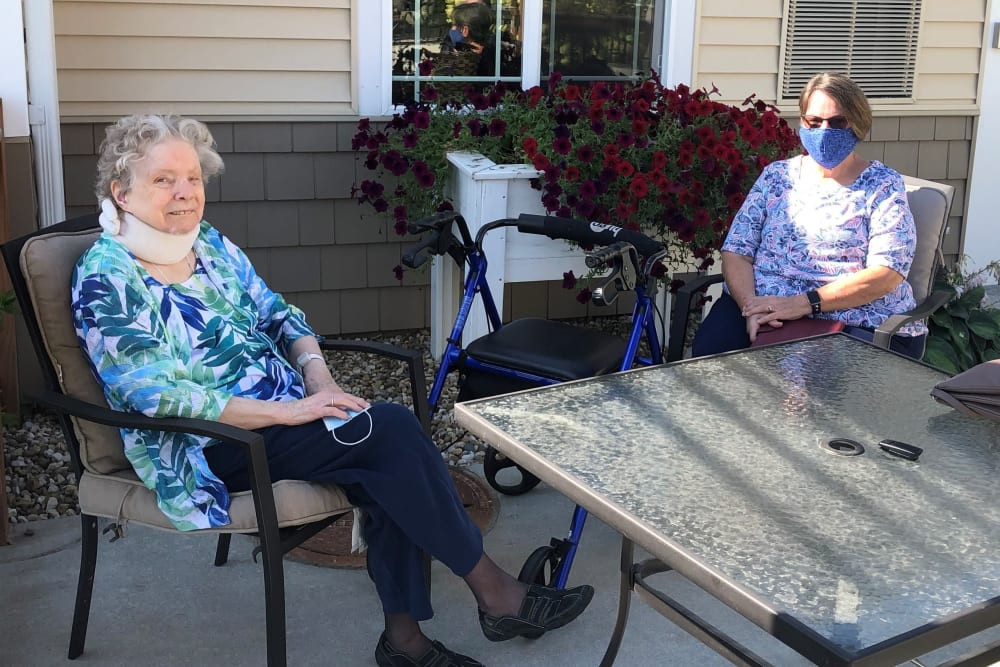 Residents sitting outside at Emery Place in Robins, Iowa