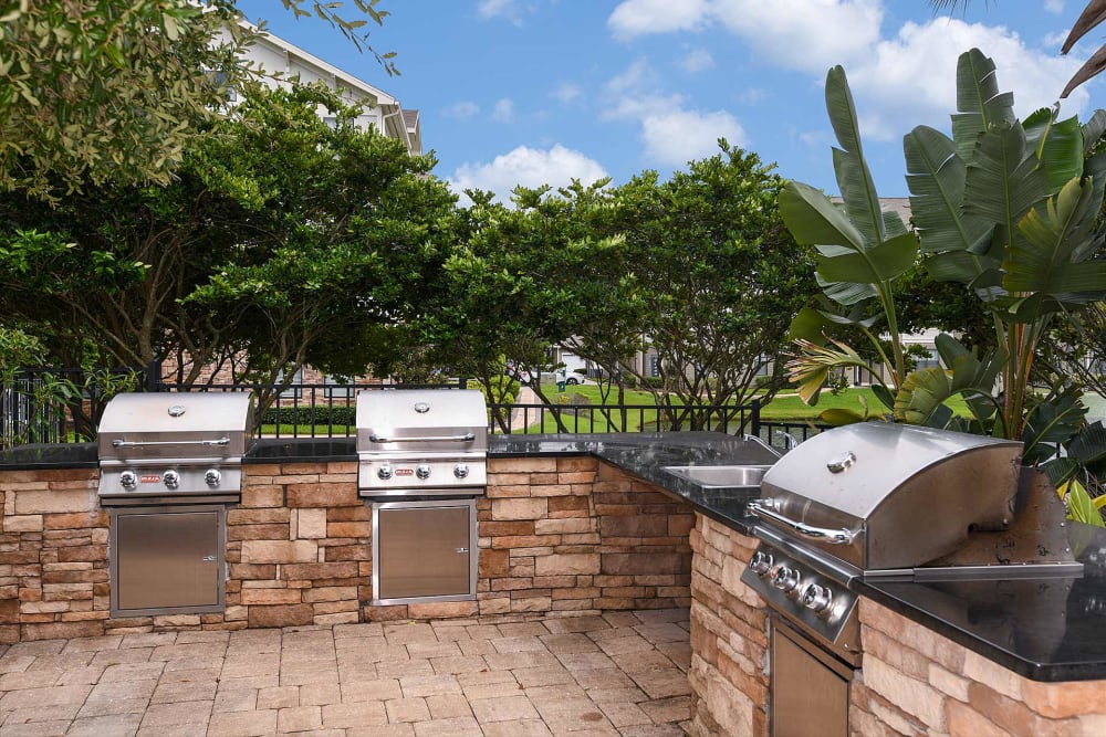 Grills by the pool at Terraces at Town Center in Jacksonville, Florida