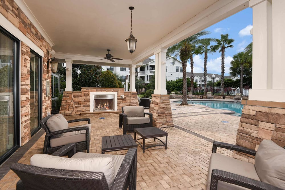 Sitting area by the pool at Terraces at Town Center in Jacksonville, Florida