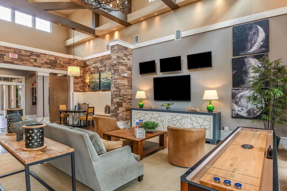 Clubhouse lounge with shuffle board at Terraces at Town Center in Jacksonville, Florida