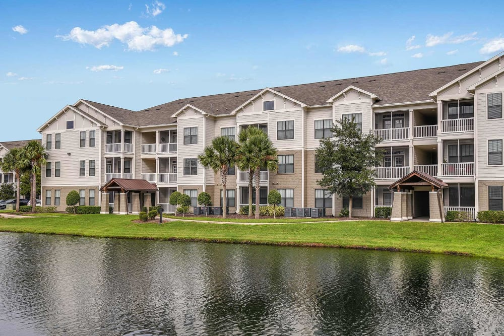 Pond of water outside of the apartments at Terraces at Town Center in Jacksonville, Florida