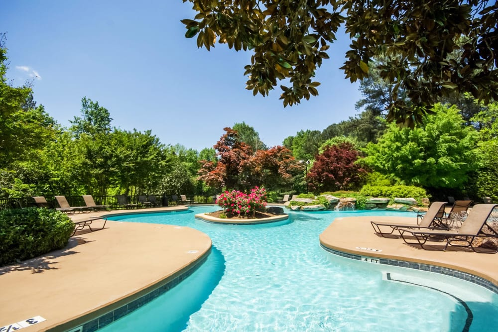 Resort-style swimming pool surrounded by lush flora at Park at Vinings in Smyrna, Georgia