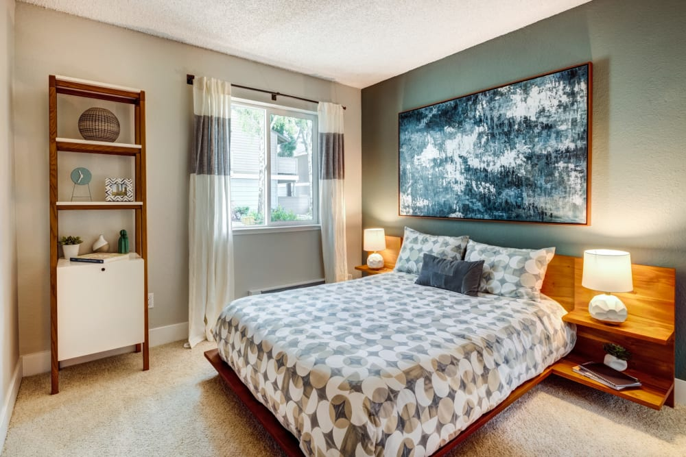 Bedroom with accent wall at Sofi Union City in Union City, California