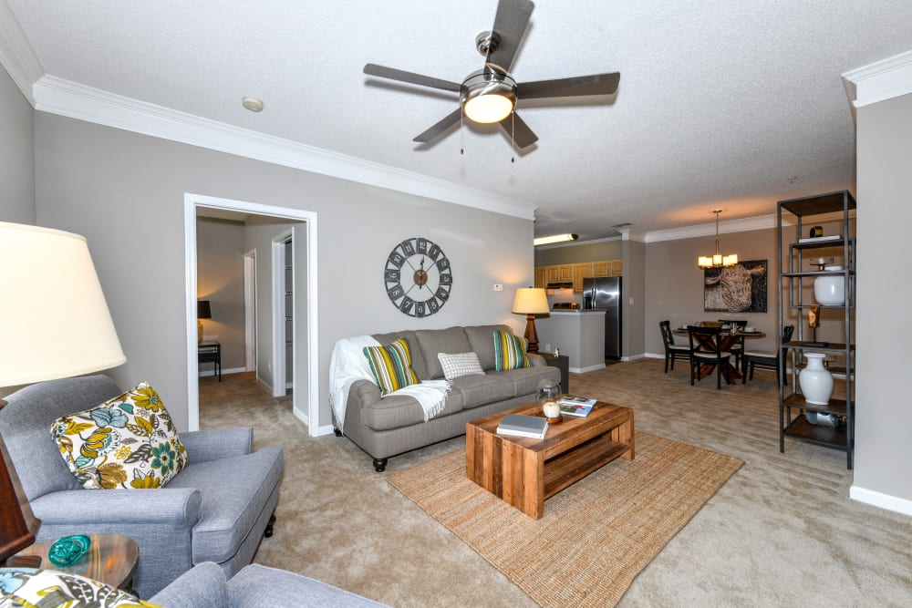 Ceiling fan in the well-furnished living area of a model home at 860 South in Stockbridge, Georgia