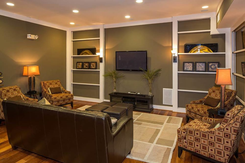 Spacious living area with classic furnishings and built-in shelving in a model apartment at The Preserve at Greison Trail in Newnan, Georgia