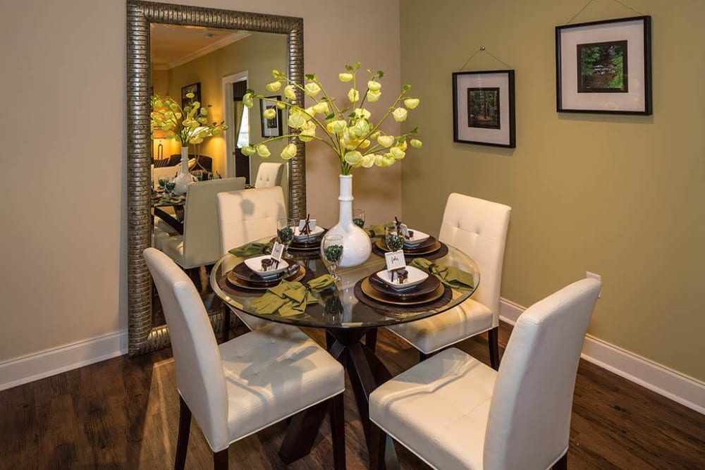 Dining area with an accent wall in a model apartment at The Preserve at Greison Trail in Newnan, Georgia