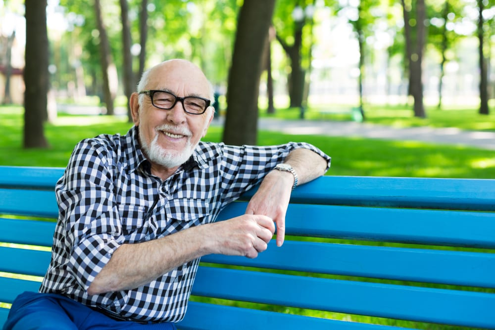 A resident on a bench near Merrill Gardens at Auburn in Auburn, Washington.