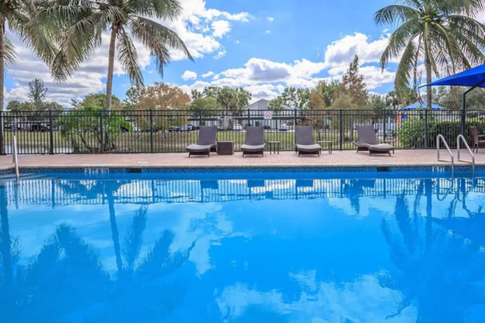 Inviting swimming pool on a beautiful day at The Coast of Naples Florida in Naples, Florida