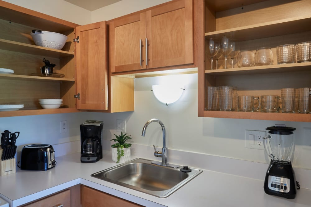 Well stocked model kitchen at Oro Vista Apartments in Oro Valley, Arizona
