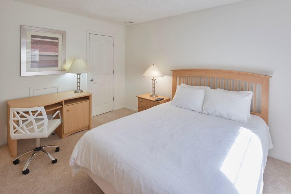 Well lit model bedroom at Sage Luxury Apartment Homes in Phoenix, Arizona