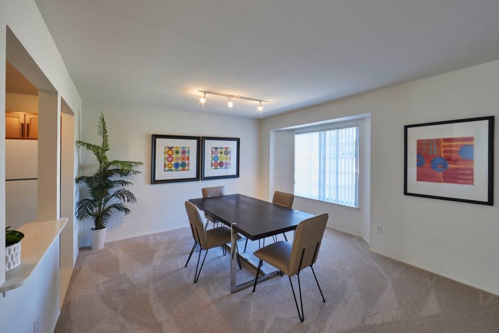 Open concept floor plan with a view of dining nook at Fairmont Park Apartments in Farmington/Farmington Hills, Michigan