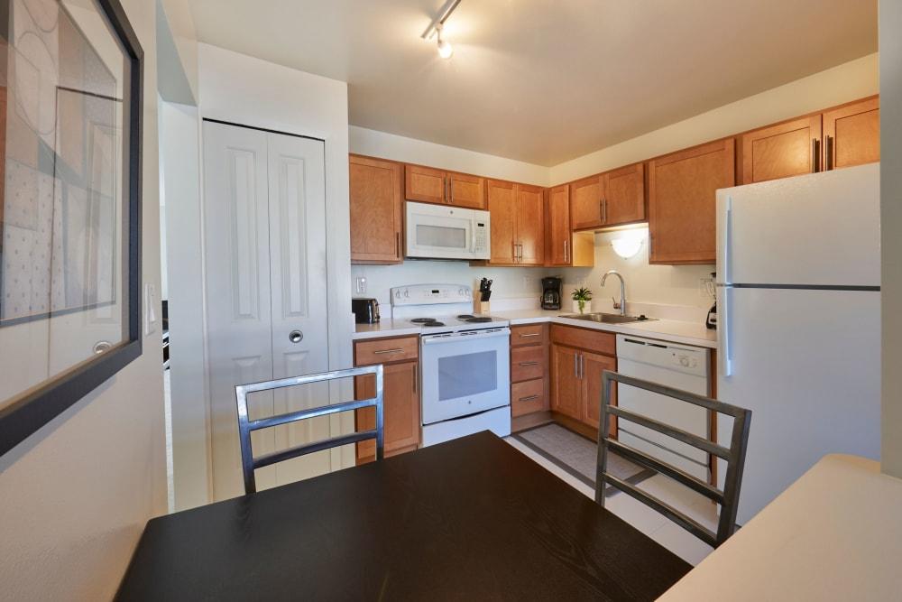 View of kitchen from dining nook at Fairmont Park Apartments in Farmington/Farmington Hills, Michigan