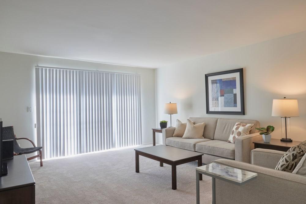 Well decorated model living room at Fairmont Park Apartments in Farmington/Farmington Hills, Michigan