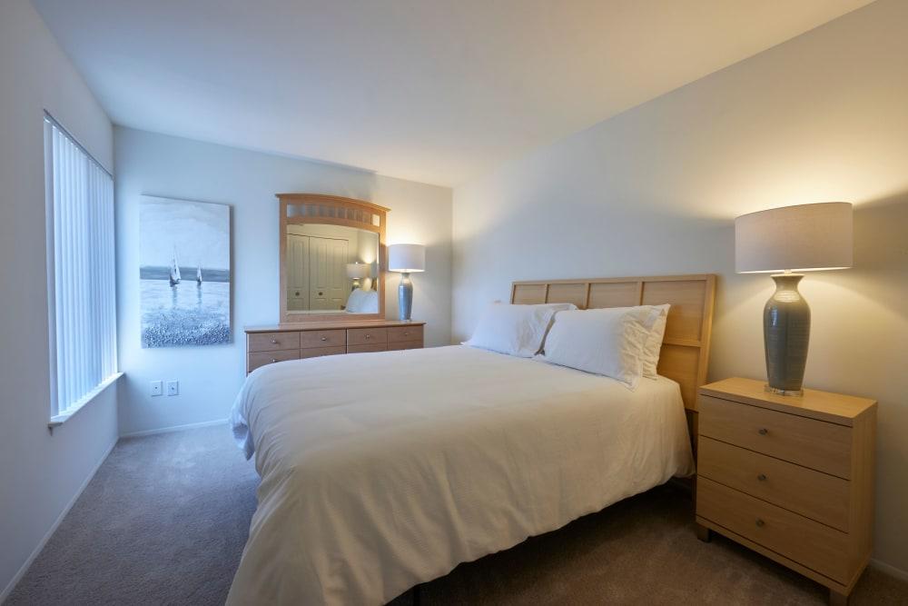 Well decorated model bedroom at Fairmont Park Apartments in Farmington/Farmington Hills, Michigan