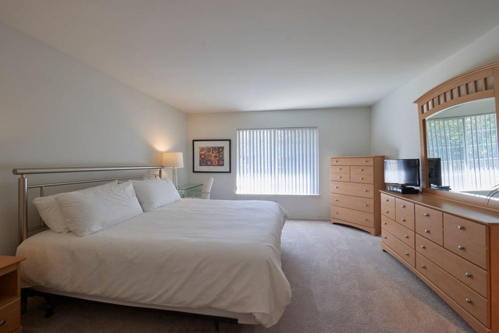 Well lit model bedroom at Fairmont Park Apartments in Farmington/Farmington Hills, Michigan
