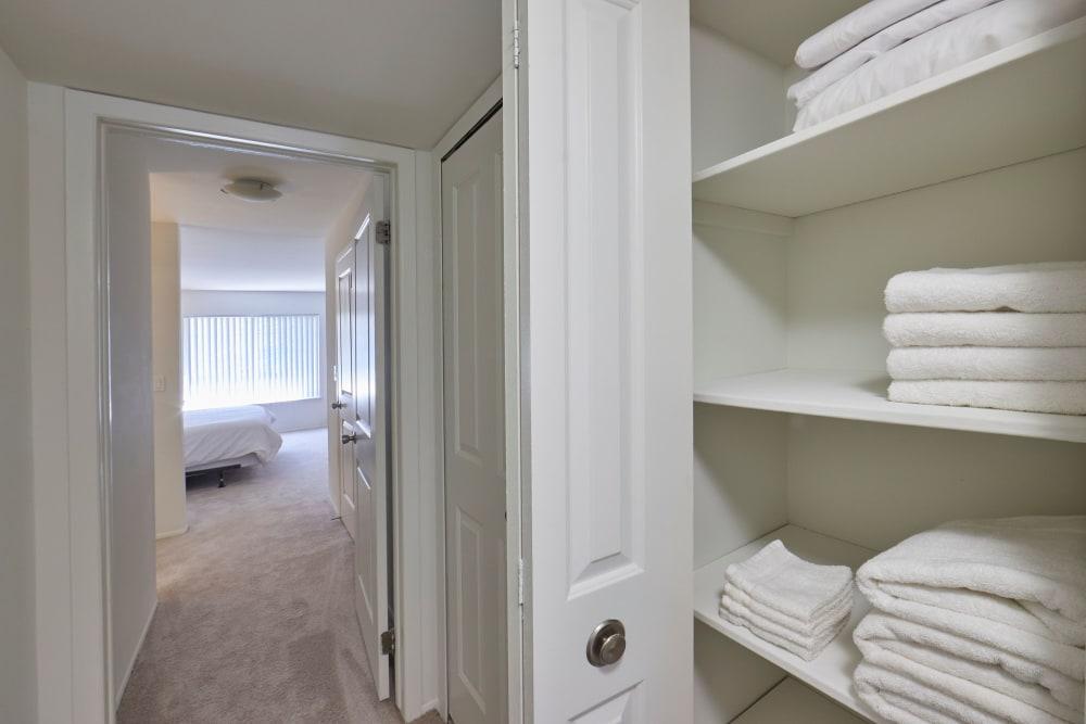 Closet full of linens in model hallway at Fairmont Park Apartments in Farmington/Farmington Hills, Michigan