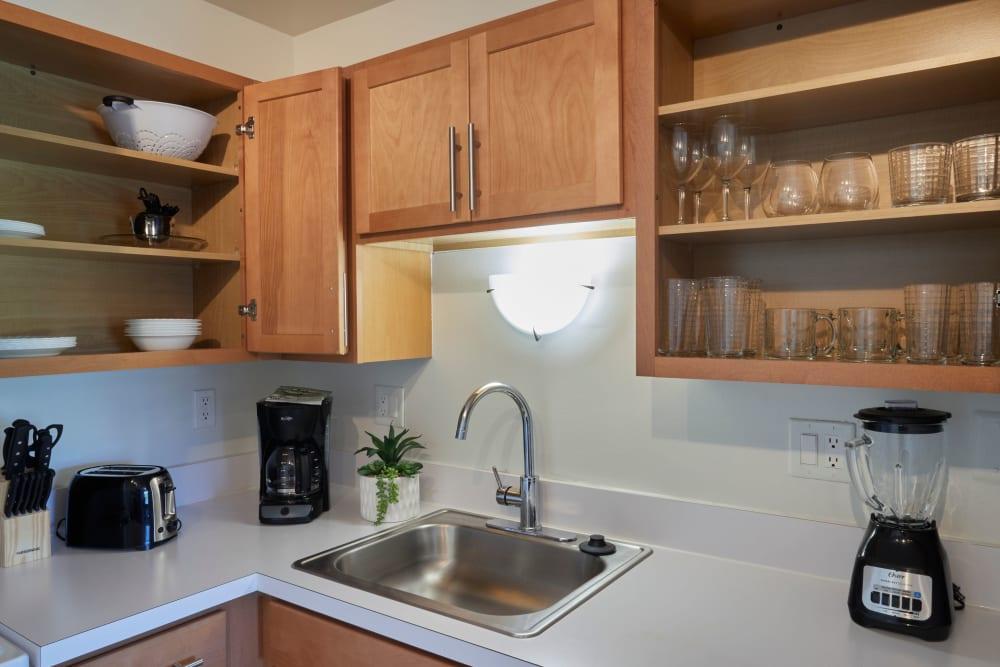 Well stocked kitchen at Fairmont Park Apartments in Farmington/Farmington Hills, Michigan