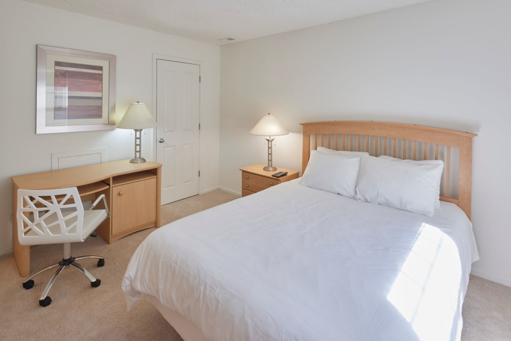 Well lit model bedroom with desk at Briar Cove Terrace Apartments in Ann Arbor, Michigan
