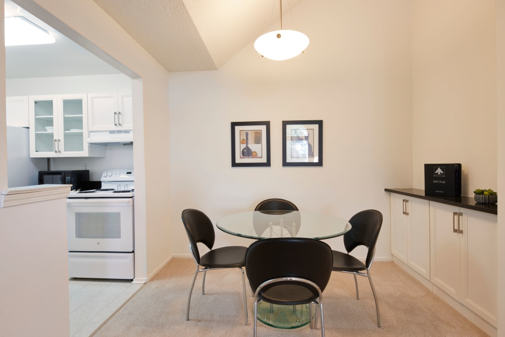 Dining nook adjacent to model kitchen at Briar Cove Terrace Apartments in Ann Arbor, Michigan