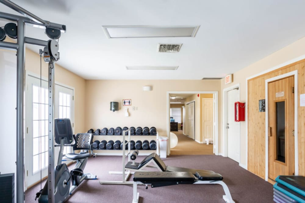 Fitness center at Bennington Hills Apartments in West Henrietta, New York
