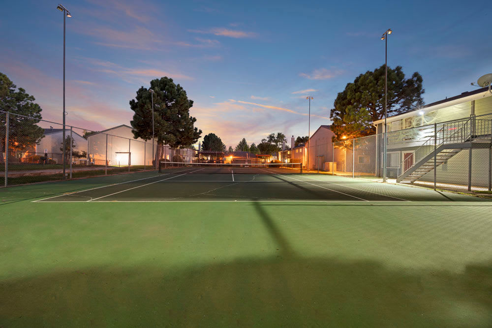Tennis courts in the evening at Hampden Heights Apartments in Denver, Colorado