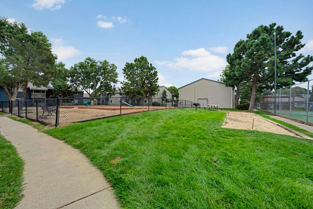 Picnic tables and recreation activities at Hampden Heights Apartments in Denver, Colorado