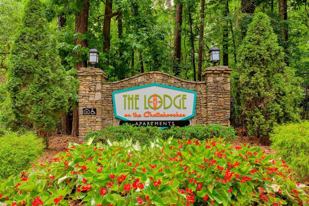 Monument sign with beautiful landscaping at The Lodge on the Chattahoochee Apartments