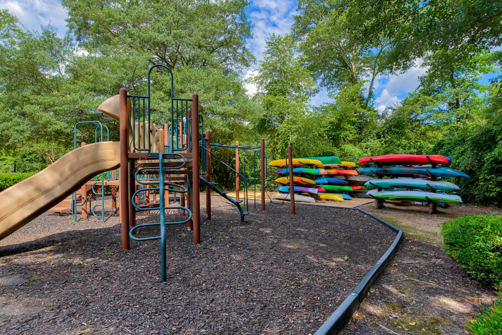Playground and kayak storage at The Lodge on the Chattahoochee Apartments in Sandy Springs, Georgia