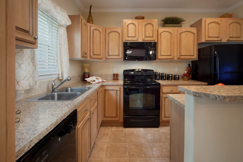 Kitchen with wooden cabinets at Keys Lake Villas in Key Largo, Florida