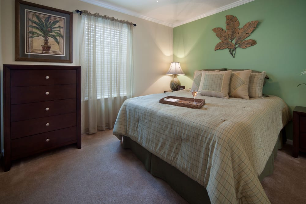 Bedroom with green wall at Keys Lake Villas in Key Largo, Florida