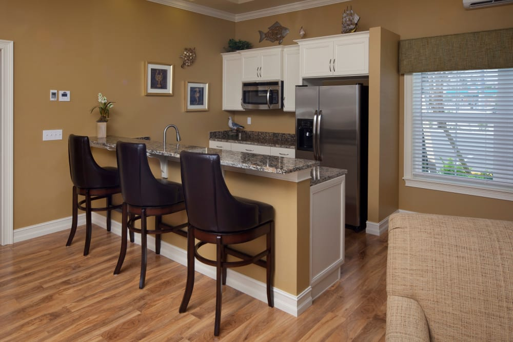 Dining area and kitchen at Keys Lake Villas in Key Largo, Florida