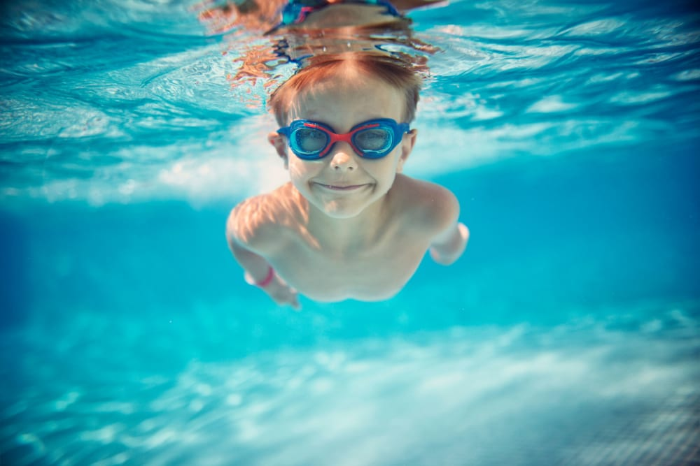 Kid swimming in the pool at City View Apartments in Nashville, Tennessee