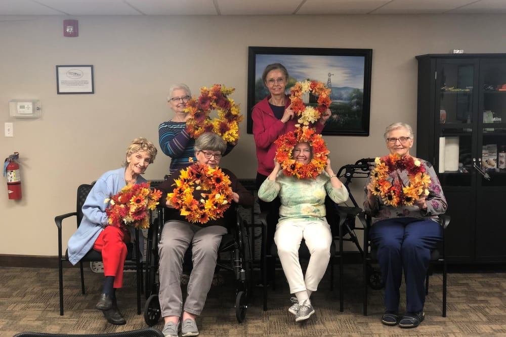 Residents displaying their wreaths at Brown Deer Place in Coralville, Iowa