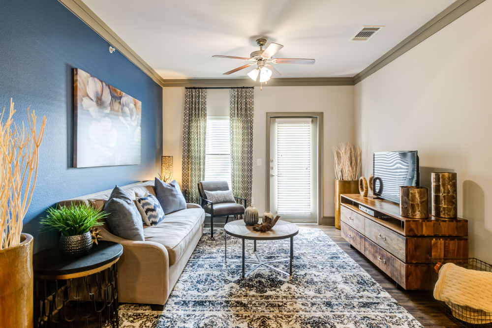 Well decorated model living room at The Sovereign in Fort Worth, Texas