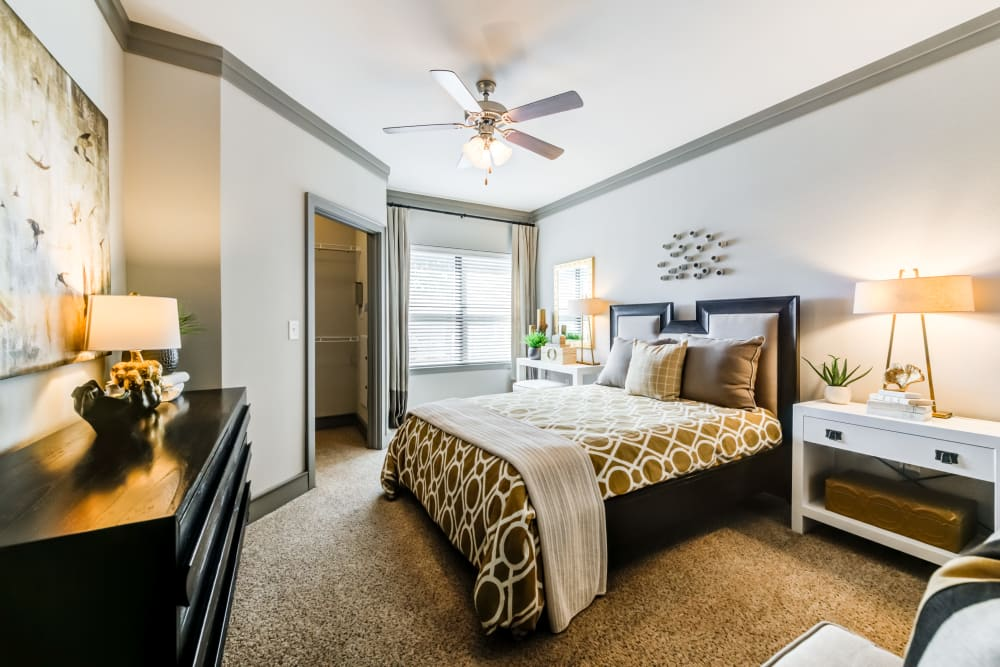 Well decorated model bedroom at The Sovereign in Fort Worth, Texas